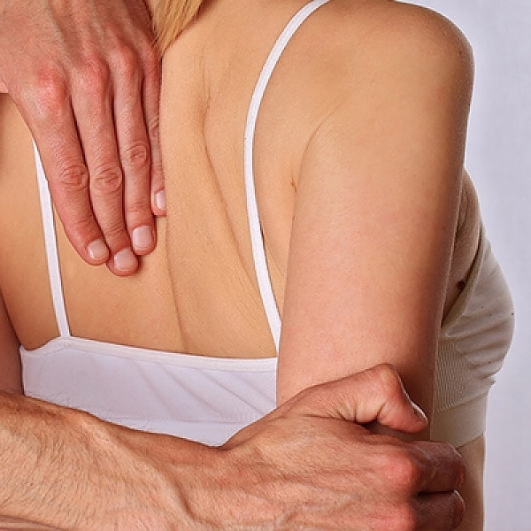 manual-therapy-on-female-back_Easy-Resize.com